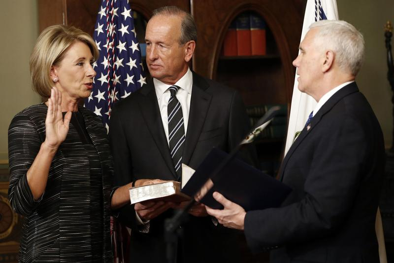 Vice President Mike Pence swears in Education Secretary Betsy DeVos in the Eisenhower Executive Office Building in the White House complex in Washington, DC. (Pablo Martinez Monsivais/AP)