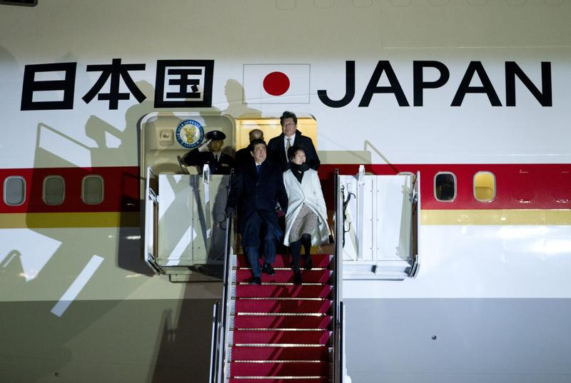 Japanese Prime Minister Shinzo Abe and his wife Akieas arrive at Andrews Air Force Base, Md. Abe is set to meet with President Donald Trump, becoming the second world leader to meet with Trump. (Jose Luis Magana/AP Photos)