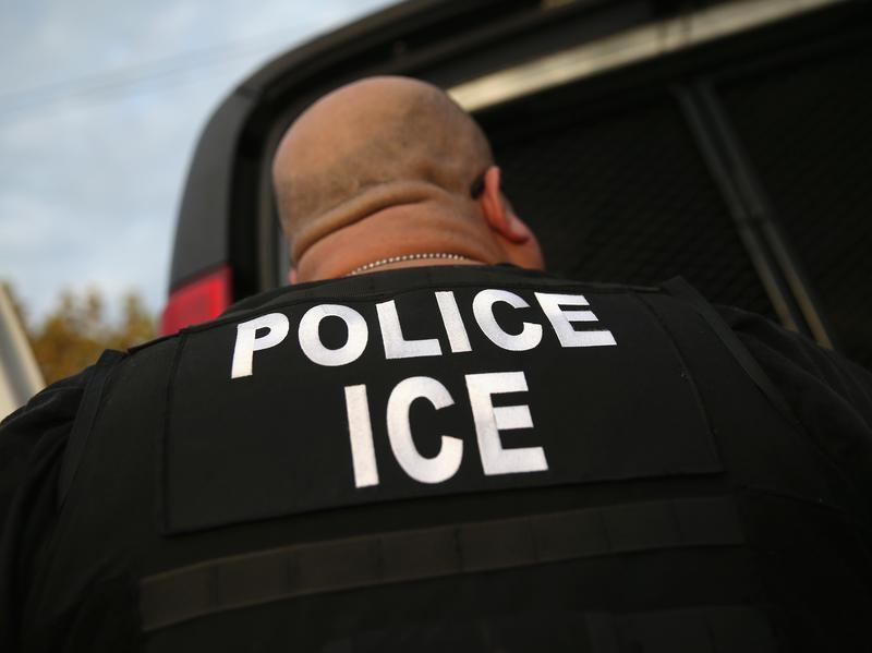An Immigration and Customs Enforcement agent detains an immigrant in 2015 in Los Angeles. A new round of detentions this week has triggered complaints from immigrant advocates.