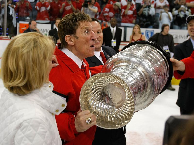 Owner Mike Ilitch of the Detroit Red Wings celebrates with the Stanley Cup in 2008 after the team defeated the Pittsburgh Penguins in six games. The team won four NHL titles under his ownership. His Detroit Tigers teams made it to two World Series.