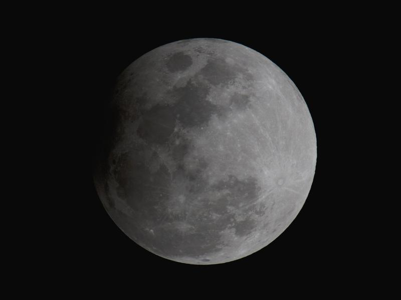 """The """"Snow Moon""""during the peak of the penumbral lunar eclipse on Friday night, as seen from Orlando, Fla."""