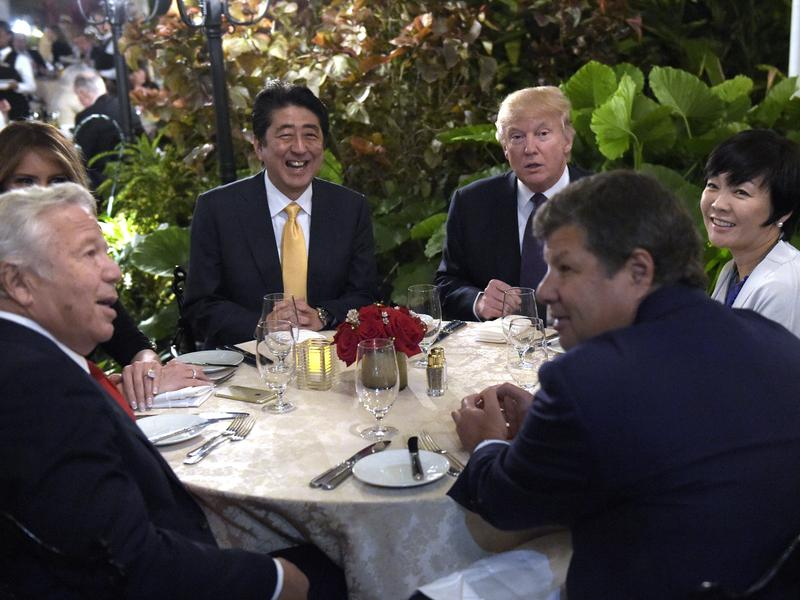 President Trump and first lady Melania Trump (hidden at left) have dinner with Japanese Prime Minister Shinzo Abe and his wife, Akie, at Mar-a-Lago in Palm Beach, Fla., on Feb. 10. Trump said he would personally pay for the visit to his resort .