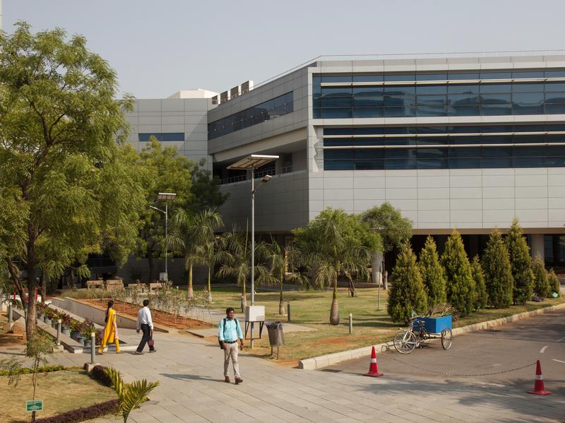 An employee walks along a path at the Tata Consultancy Services Ltd. Synergy Park campus in Hyderabad, India, in 2016. Some in-house PG&E employees will be replaced by workers from TCS.