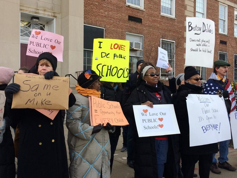 Protesters gather outside Jefferson Middle School in Washington, where Education Secretary Betsy DeVos paid her first visit as education secretary.