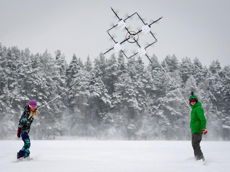 Snowboarders are pulled by a drone on a lake near Cesis, Latvia, in January.