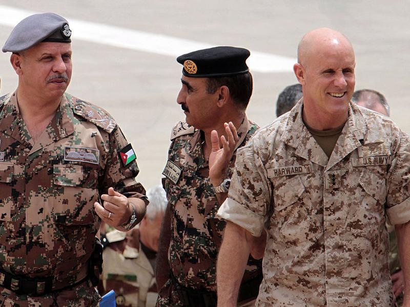 Then-deputy director of CENTCOM, U.S. Navy Vice Admiral Robert Harward, is pictured with  Jordan's Prince Faisal and the Army's head of operations and training Major General Awni Adwan in a May 2012 photo. Harward is now under consideration to replace Michael Flynn as President Trump's national security adviser.