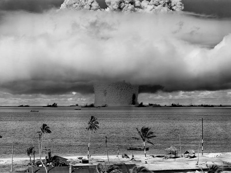Vintage American history photo of a nuclear weapon test by the American military at Bikini Atoll, Micronesia on July 25, 1946. The explosion was part of Operation Crossroads.