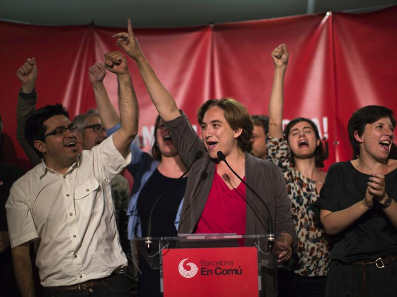 Ada Colau, center, celebrates after her election as Barcelona's mayor in 2015.