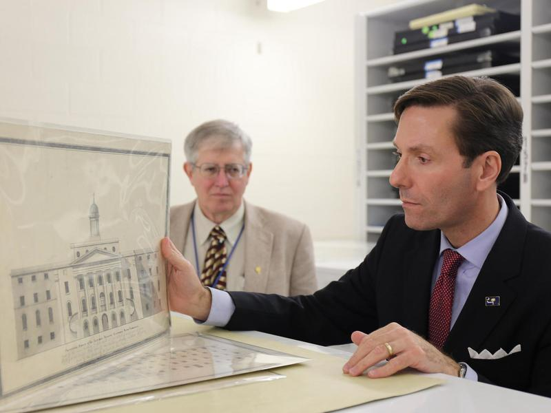 Pat McCawley (left) and Eric Emerson look at a drawing of an asylum built in Columbia, S.C., in the 1820s. <em></em>