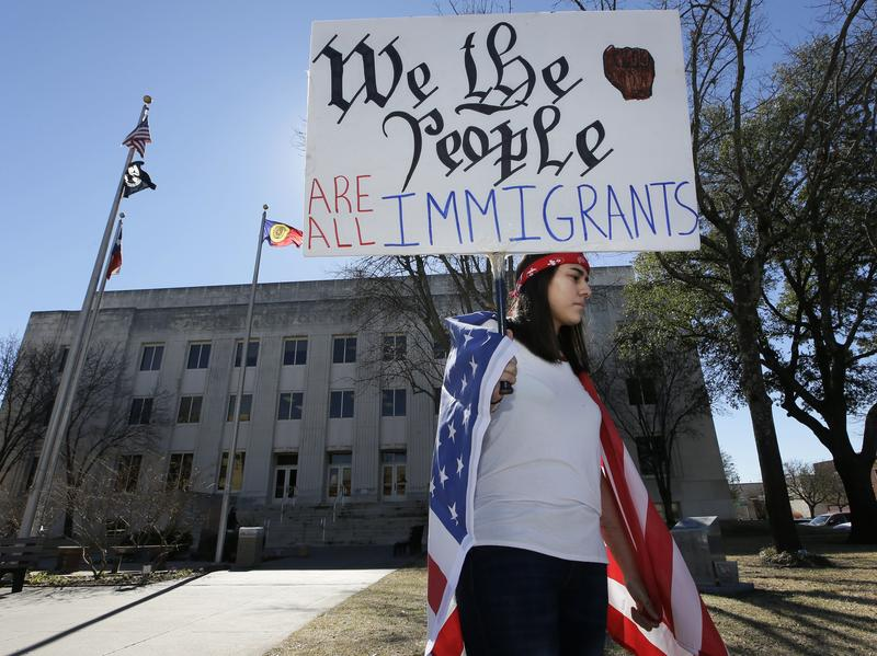 Observing a Day Without Immigrants, high school senior Vicky Sosa holds a sign outside the Grayson County courthouse in Sherman, Texas, Thursday.