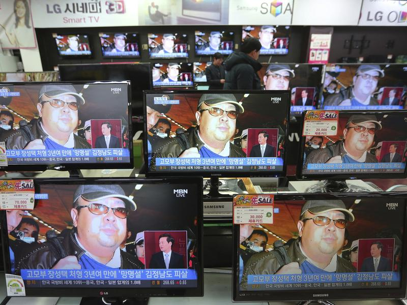 TV screens in Seoul, South Korea, show images Wednesday of Kim Jong Nam, the half-brother of North Korean leader Kim Jong Un. On Tuesday, Kim Jong Nam was killed in Kuala Lumpur, Malaysia.