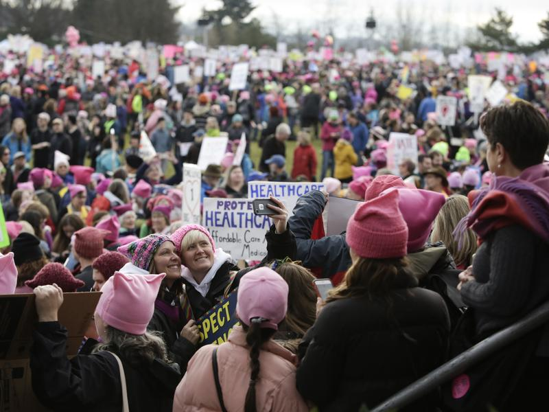 "Led by women in pink ""pussy hats,"" hundreds of thousands of people packed the streets of Washington and other cities in a massive outpouring of opposition to America's new president, Donald Trump."