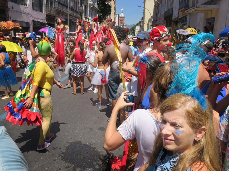 People enjoy an informal parade before carnival in Rio's Zona Central.