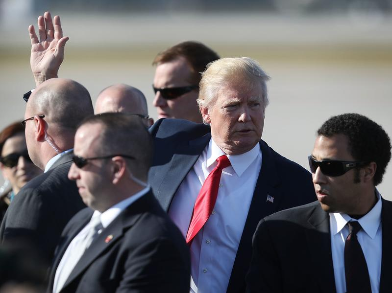 President Trump waves on Friday after arriving on Air Force One at the Palm Beach International Airport to spend the weekend at Mar-a-Lago resort in West Palm Beach. It's the third straight weekend he's spent at his Florida resort.