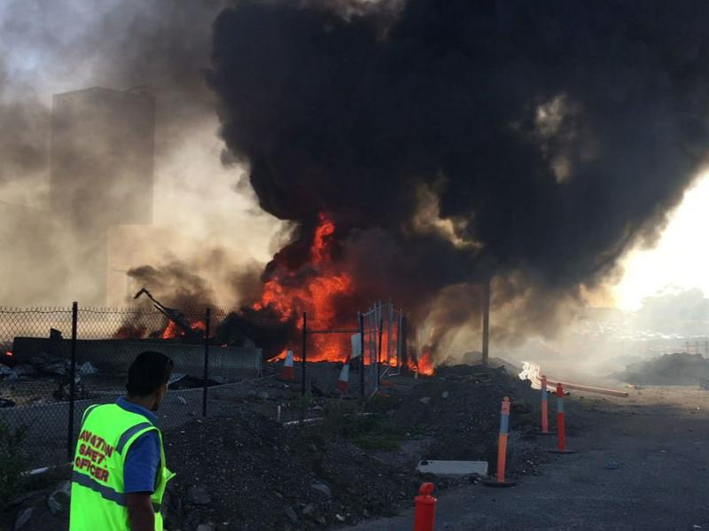 Smoke and flames rise after a Beechcraft plane crashed into a shopping center after it took off from Essendon Airport in suburban Melbourne, Australia.