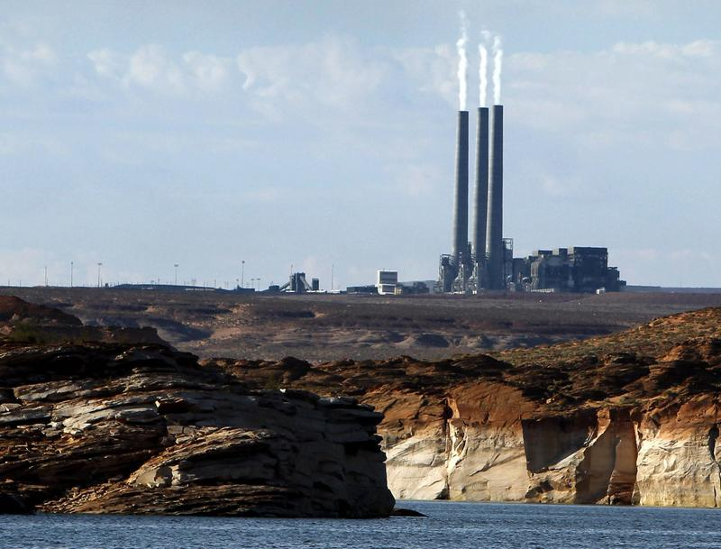 This Sept. 4, 2011 file photo shows the main plant facility at the Navajo Generating Station, as seen from Lake Powell in Page, Ariz. The plant is slated to close in 2019. (Ross D. Franklin/AP)