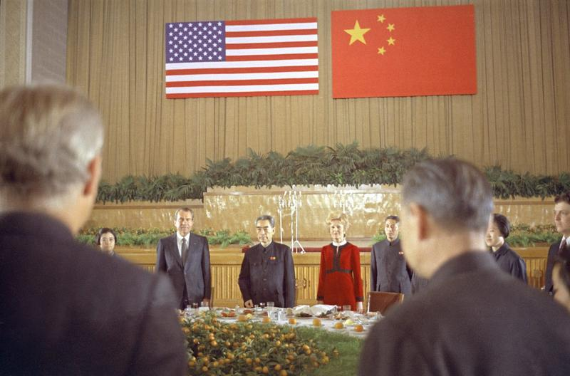 Chinese Premier Chou En Lai is flanked by U.S. President Richard Nixon and first lady Pat Nixon, during a farewell banquet in Shanghai marking the Nixon's last day in China, Feb. 28, 1972. (AP)