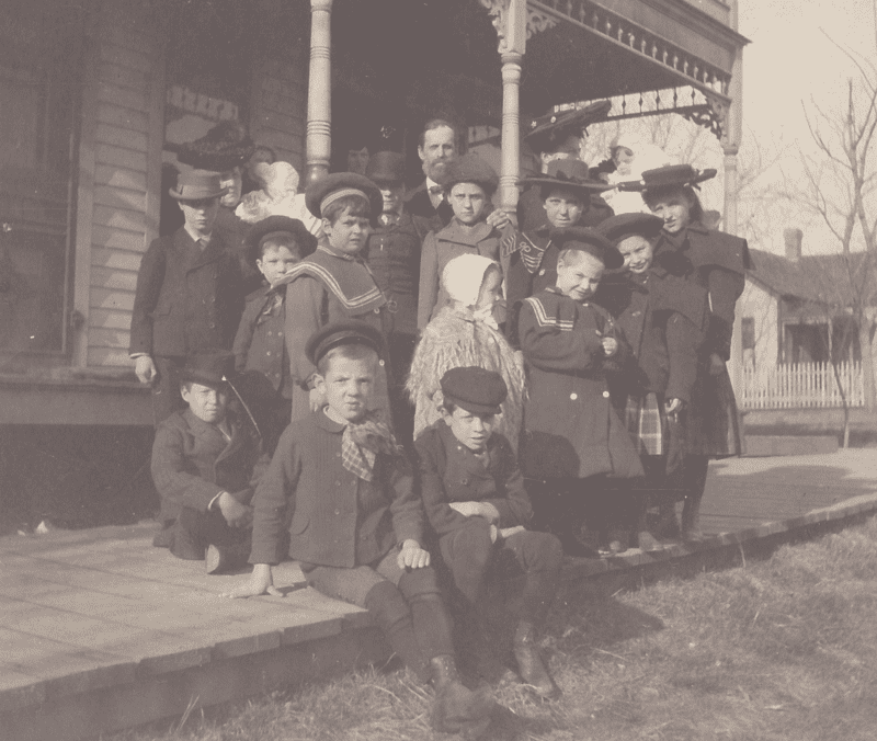 Children's Aid Society placement agents Anna Laura Hill (back row, right, wearing a large hat), H.D. Clark and Mrs. Clark (back row, left) with a company of children. (Courtesy of National Orphan Train Complex)