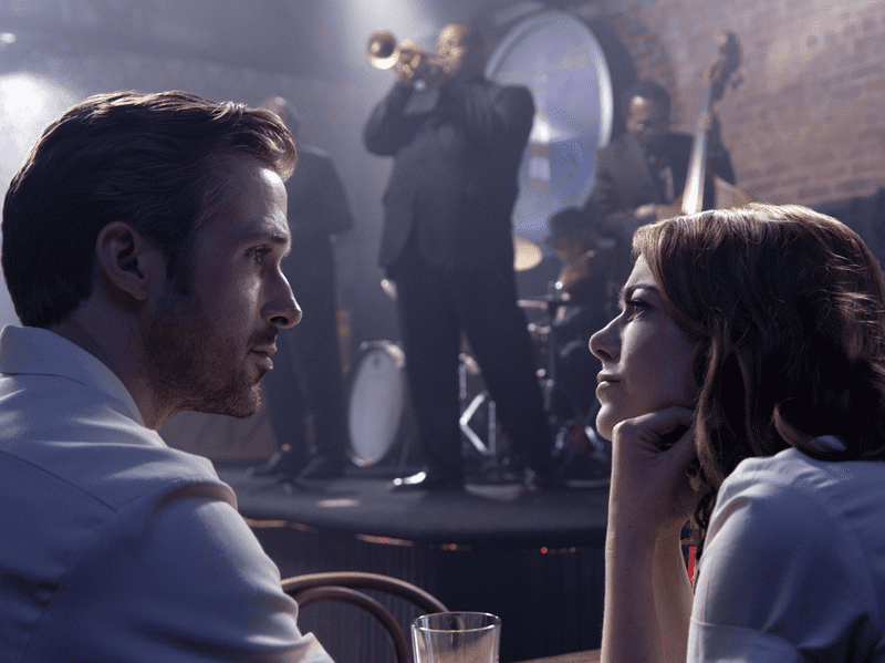 "Ryan Gosling and Emma Stone at a jazz club in the movie ""La La Land""."