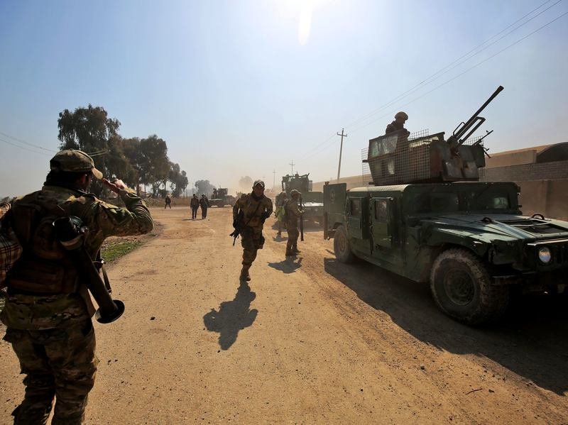 Iraqi forces gather at Mosul's airport during an offensive to retake the western side of the city from ISIS Thursday. Government forces reportedly entered the airport on the southern edge of the city for the first time since 2014.
