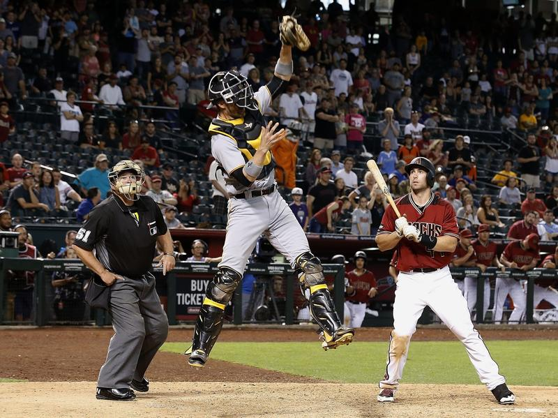 Pittsburgh Pirates catcher Chris Stewart grabs an intentional walk throw in a game between Arizona and Pittsburgh last year in Phoenix.