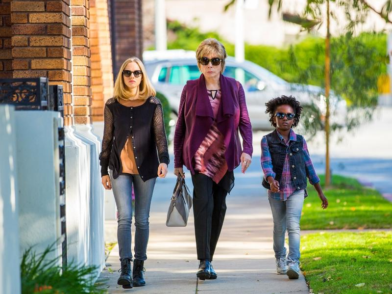Ok it'd be awesome if that car behind them exploded right now (spoiler: it won't). L to R: Amanda Seyfried, Shirley MacLaine, AnnJewel Lee Dixon in <em>The Last Word</em>.