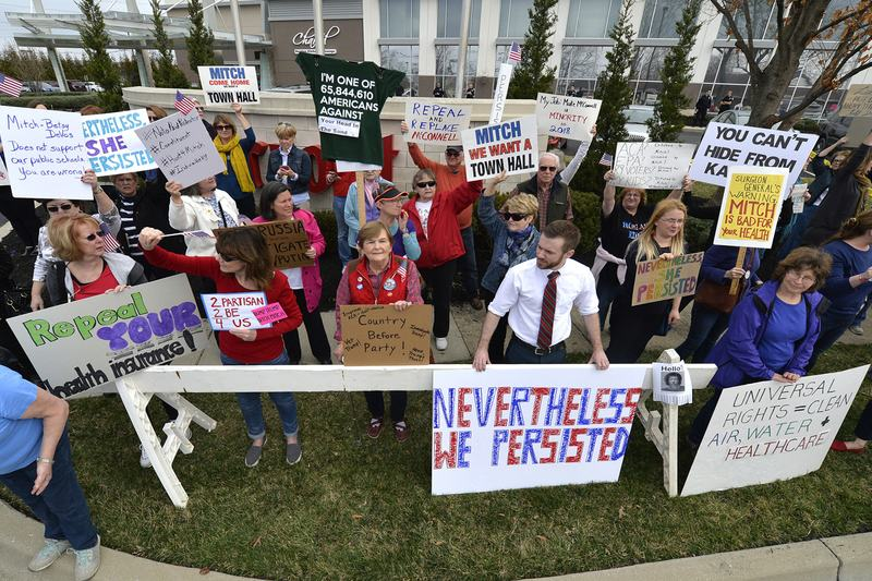 A group numbering in the hundreds gather to protest the appearance of Senate Majority Leader Mitch McConnell R-Ky., and the policies of the Trump administration outside of the Jeffersontown Chamber of Commerce luncheonn Jeffersontown, Ky. (Timothy D. Easley/AP)