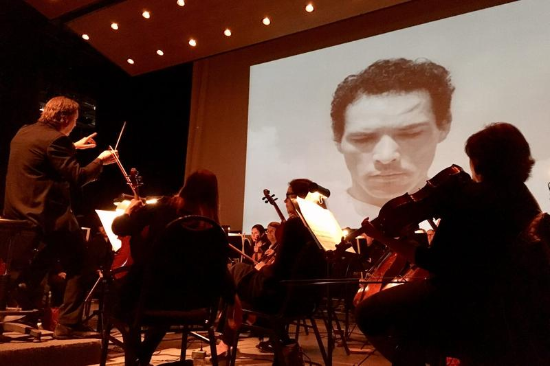 """A screening of the iconic Mexican film """"Redes"""" at the Music Unwound Festival, accompanied by the El Paso Symphony Orchestra, which performed the score live. (Armando Trull/WAMU)"""