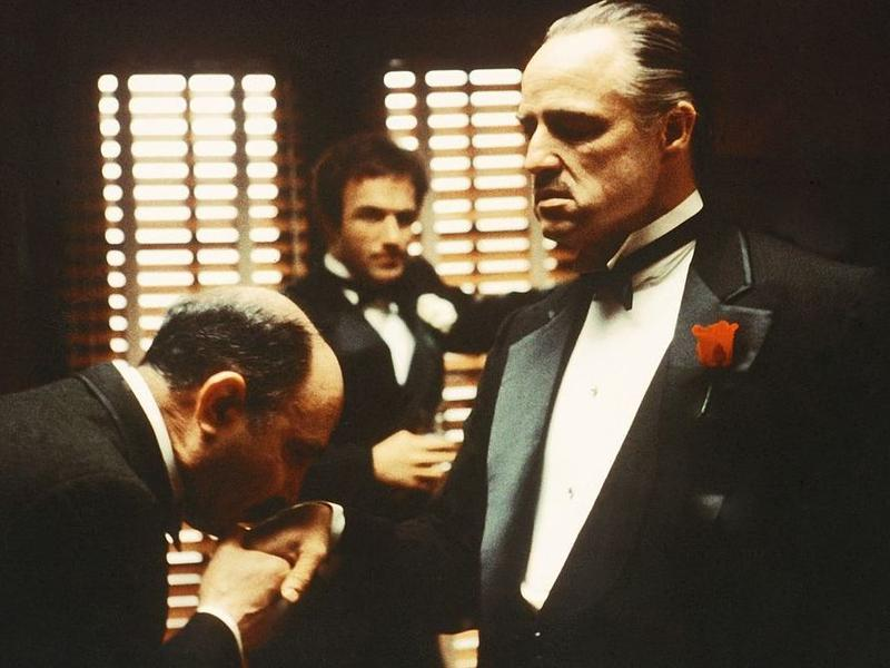 From left to right, Salvatore Corsitto as Bonasera, James Caan as Santino 'Sonny' Corleone and Marlon Brando as Don Vito Corleone in 'The Godfather'.