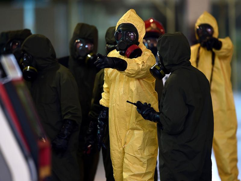 Members of Malaysia's hazardous materials team conduct a decontamination operation at the Kuala Lumpur International Airport on Sunday.