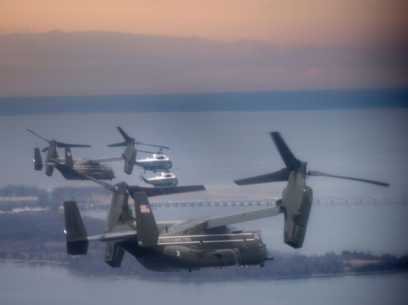 """Marine One, with President Trump aboard, flies with a decoy and support helicopters to Dover Air Force Base for the dignified transfer of Navy SEAL Chief Petty Officer William """"Ryan"""" Owens, who was killed in Yemen on Jan. 29. Owens' father says he refused to meet Trump."""