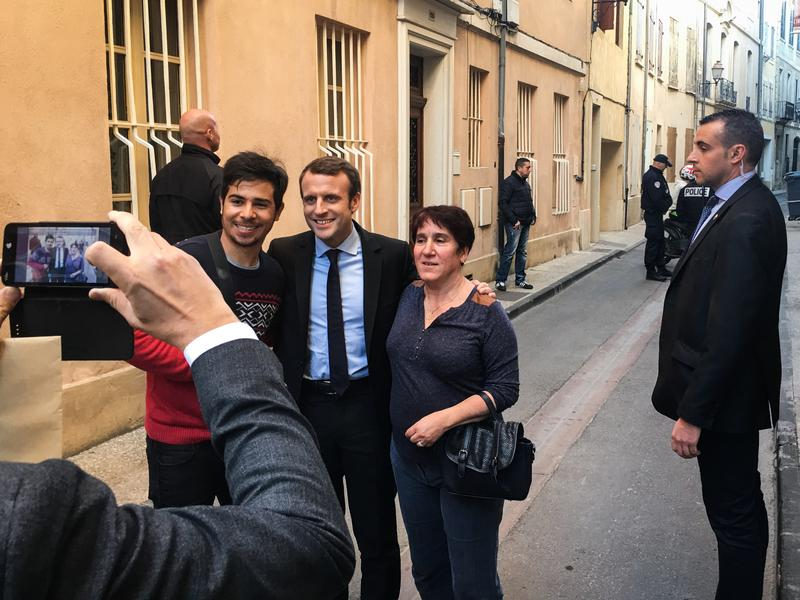 Emmanuel Macron has a photo taken with fans in the southern town of Carpentras, where he campaigned earlier this month. Macron has bucked the two-party system to run as an independent.