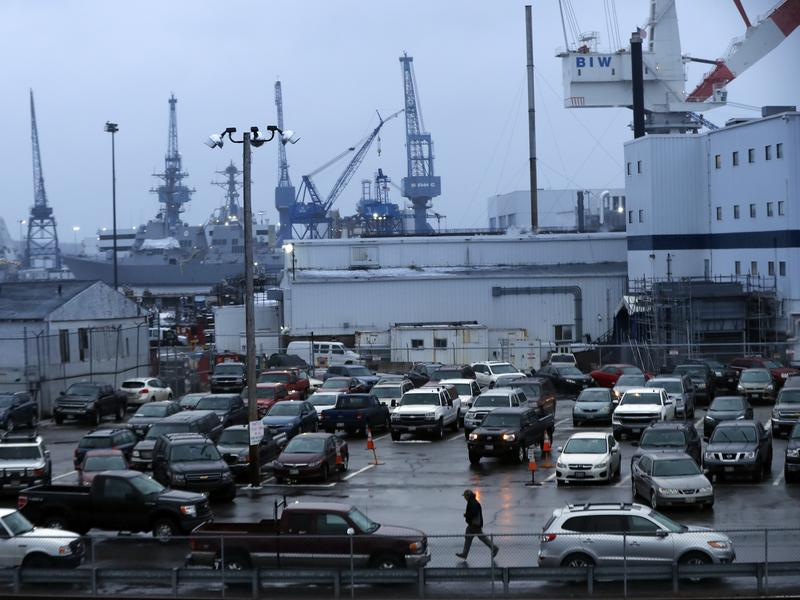 A shipyard worker walks to his car at the end of the workday at Bath Iron Works in Bath, Maine. With President Trump demanding more ships, the Navy is proposing the biggest shipbuilding boom since the end of the Cold War to meet potential threats from Russia and China.