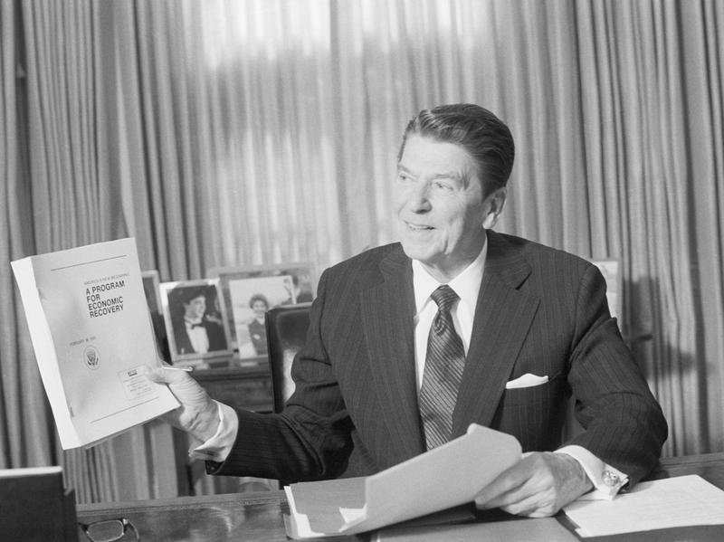 President Reagan holds up the book form of his economic plan, which he presented to Congress on Feb. 18, 1981. In addressing Congress, presidents often present specific policy proposals and plans for the nation.