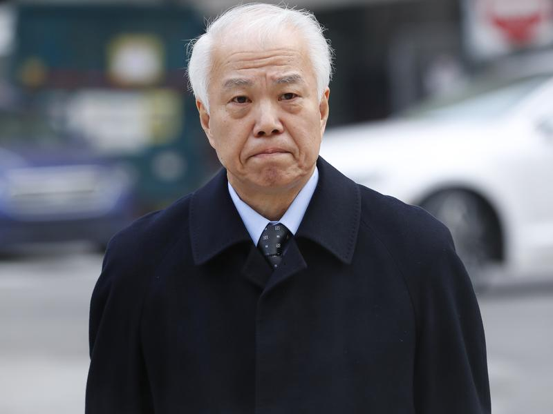 Takata Corp.'s chief financial officer Yoichiro Nomura leaves federal court in Detroit on Monday. Japanese auto parts maker Takata Corp. pleaded guilty to fraud and agreed to pay $1 billion in penalties for concealing an air bag defect.