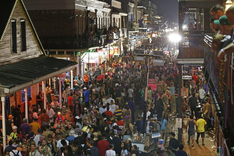 Throngs of revelers are seen from the balcony of the Royal Sonesta Hotel on Bourbon Street Mardi Gras evening in New Orleans, Tuesday, Feb. 28, 2017. (Gerald Herbert/AP)