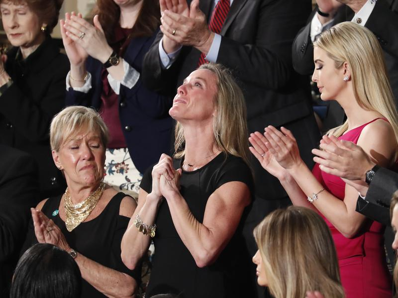 """Carryn Owens, the widow of Navy SEAL William """"Ryan"""" Owens, fought back tears as President Trump addressed her during his speech to a joint session of Congress Tuesday."""