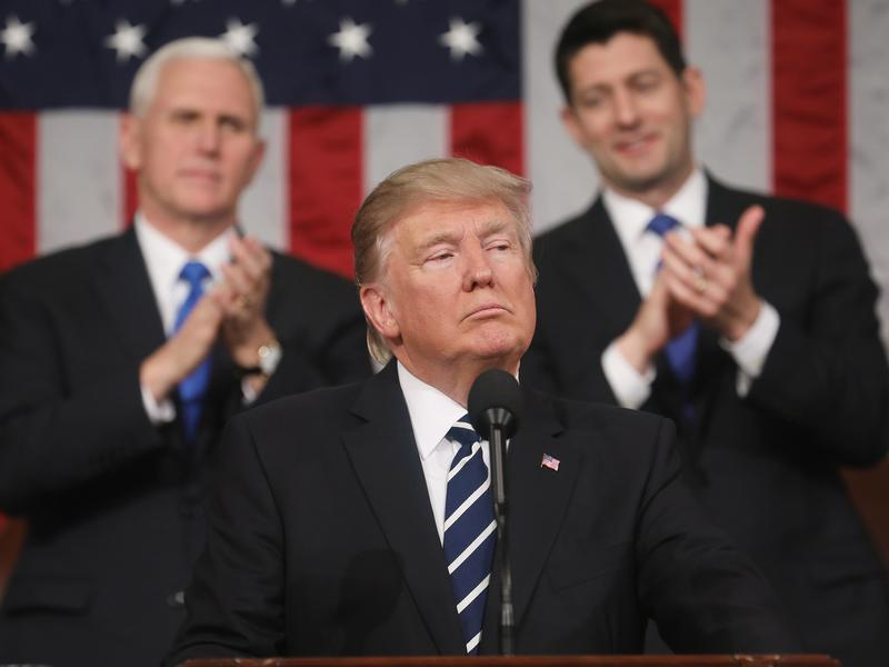 President Trump delivers his first address to a joint session of the Congress as Vice President Pence and Speaker Paul Ryan applaud on Tuesday.