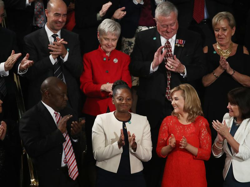 President Trump's guest Denisha Merriweather, bottom center, received Florida's tax credit scholarship, which allows students to attend private schools.