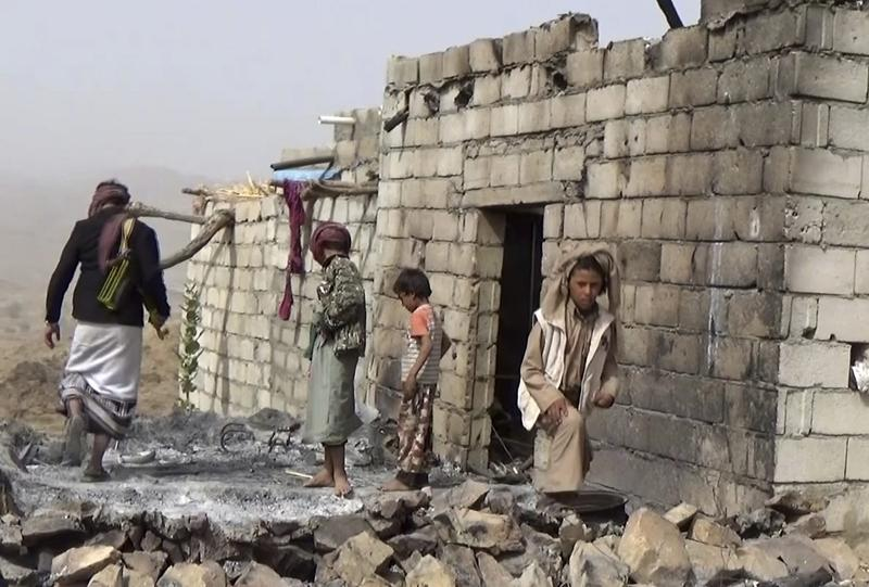 In this Feb. 3, 2017 frame grab from video, residents inspect a house that was damaged during a Jan. 29, 2017 U.S. raid on the tiny village of Yakla, in central Yemen. (AP)