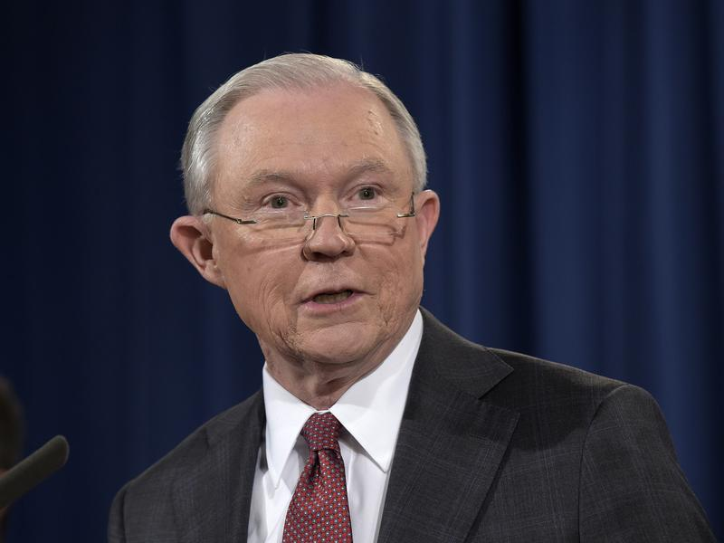 Attorney General Jeff Sessions speaks at the Justice Department on Thursday. He is under fire after reports that he had conversations with the Russian ambassador last year.