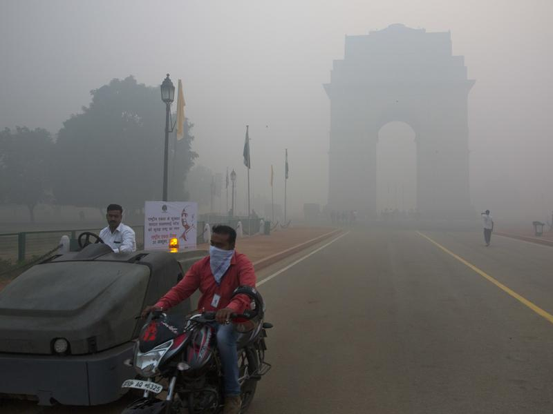 Nitrogen oxide pollution in India and China is offsetting U.S. gains in cutting emissions, researchers say. This photo from October shows road traffic, along with smoke and smog, in front of the landmark India Gate in New Delhi.