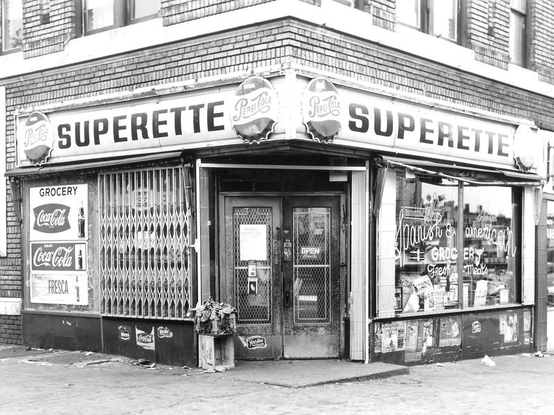 A storefront of a New York City bodega from the 1950s or '60s.