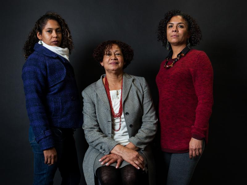 Sisters Bela Henriquez, left, and Nadiezhda Henriquez with their mother, Zulma Chacin de Henriquez, center, testified about how Giraldo Serna's drug operations destroyed their family.