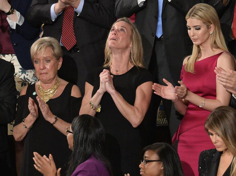 """Carryn Owens, wife of Navy SEAL William """"Ryan"""" Owens, is recognized as U.S. President Donald Trump addresses a joint session of Congress last Tuesday."""
