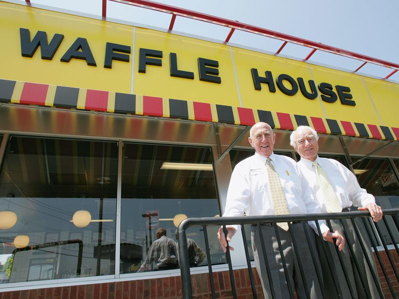 Waffle House founders Joe Rogers Sr. (left) and Tom Forkner pose in front of a Waffle House restaurant in Norcross, Ga., after eating lunch there 2005.