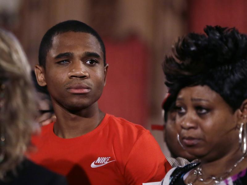 Davontae Sanford stands with his mother, Taminko Sanford, following his release after nine years in prison for murders he did not commit. He was one of 52 people exonerated for murder in 2016, according to a new report.