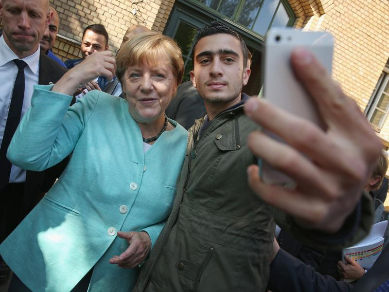 Anas Modamani, a refugee from Syria who posed for a selfie with German Chancellor Angela Merkel in 2015, sued Facebook after his photo was shared in posts falsely accusing him of being a criminal and terrorist. This week, he lost his case in court. Some lawmakers argue that cases like this prove there's a need for new, tougher libel laws.