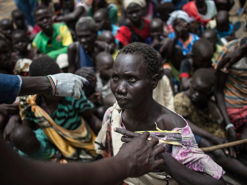 People line up to register for a food distribution in South Sudan.