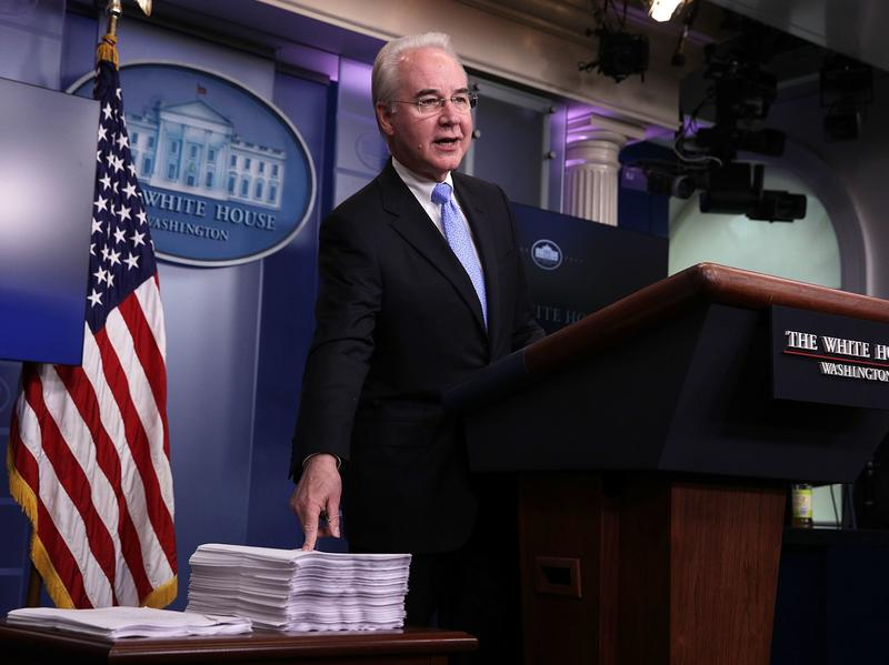 Health and Human Services Secretary Tom Price compares a copy of the Affordable Care Act (right) and a copy of the new House Republican health care bill during a White House press briefing on Tuesday.